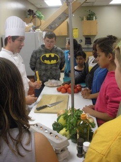 Des Moines Junior High Students with FoodsCorps Volunteer