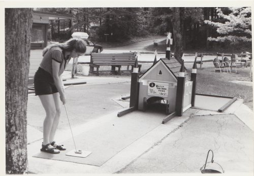 June Melby Playing Miniature Golf