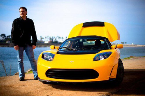 MIke Koenigs with his beloved Tesla